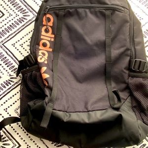 Adidas black backpack with pink logo